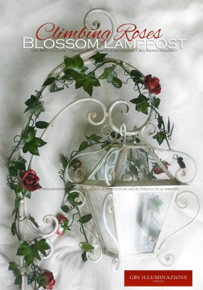 Lamppost lantern with forged arm and climbing roses for outdoor use. Ivy and roses in aged paint, just like the white gloss forged arm from the ground. Made to order.