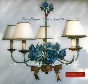 Rose Bouquet Chandelier with sky blue and deep sea roses and a green tempera finish.