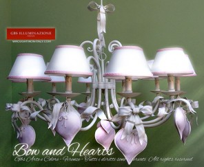 Bow and hearts, 10 light wrought iron chandelier. Romantic Bedroom