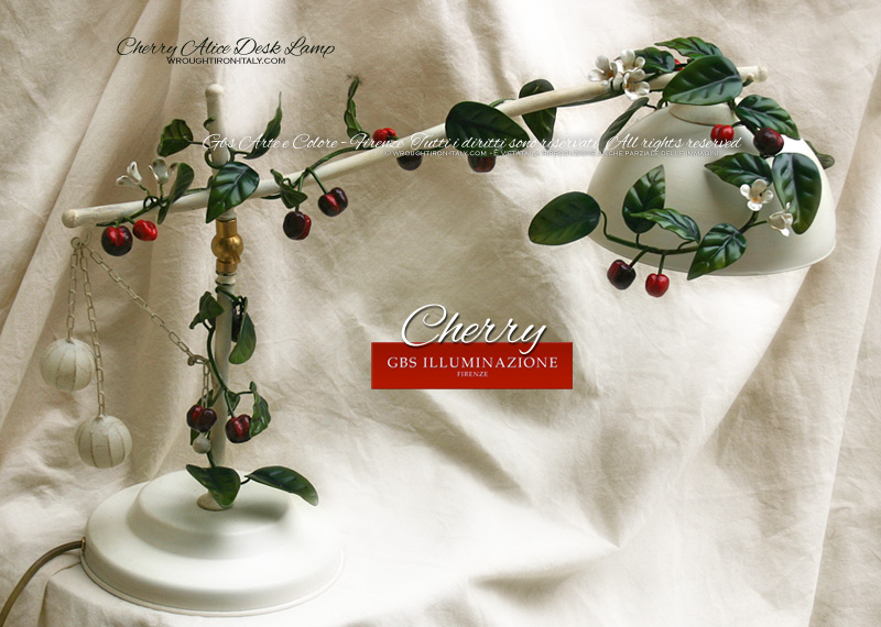 Cherry desk lamp with swivel arm and adjustable light. Hand-decorated wrought iron in white with an enamel finish.