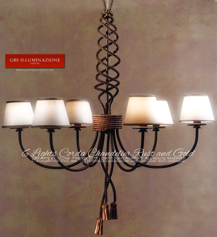 Wrought iron chandelier, rust tempera finish, details in gold patina. Corda Collection
