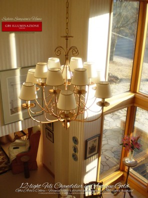 12-light Fili Classic Chandelier Antique Gold in hand-decorated wrought iron.