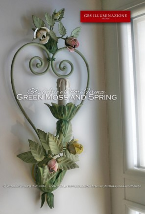 Romantic sconce with forged iron heart and small bouquets of roses and buds. Shades of green moss and spring, roses in pastel colours.